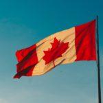Canadian flag against a blue sky